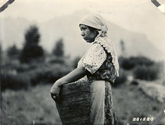 Native American women with basket of huckleberries