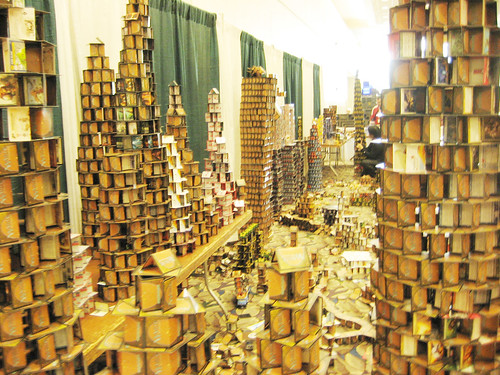 Famous Cardhalla at Gen Con: During the convention a city is constructed out of donated trading card game cards. Near the end of the convention attendees are invited to throw coins at the city to destroy it. The thrown coins are collected and donated to charity. (from Wiki Pedia)
