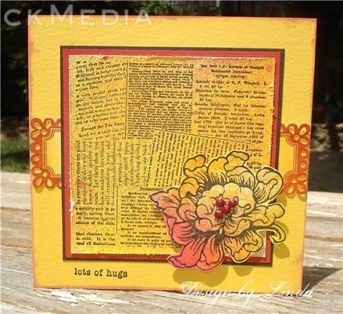 Not only did Linda use dye ink spray to spice up her card, but she also made patterned paper with the dictionary stamp.