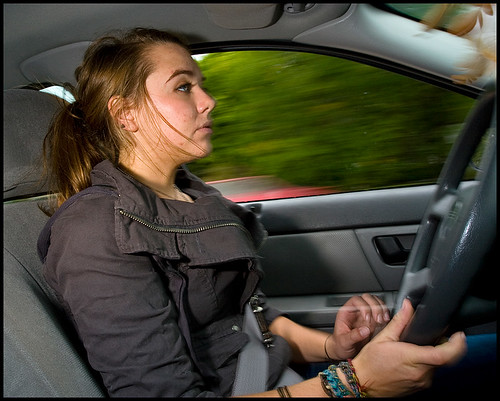 Mallory Benedict drives to the site of her Aug. 2007 crash. Benedict had been driving home from a friends house at 4 a.m. when she texted the friend for directions out of the neighborhood. While typing her message, Benedict overcorrected her steering three times, which led to her rolling and totaling her car. Although her airbags did not deploy, Benedict, who had worn her seatbelt, was not injured.