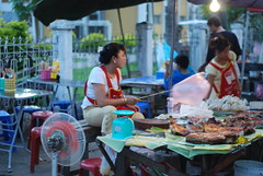 People use plastic bags attached to sticks to keep flies off of food like this one at the Louang Phabang Night Market