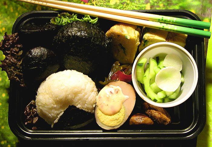 Onigiri with tuna & ume, sunomono, tamagoyaki, stewed shiitake, and a tea egg