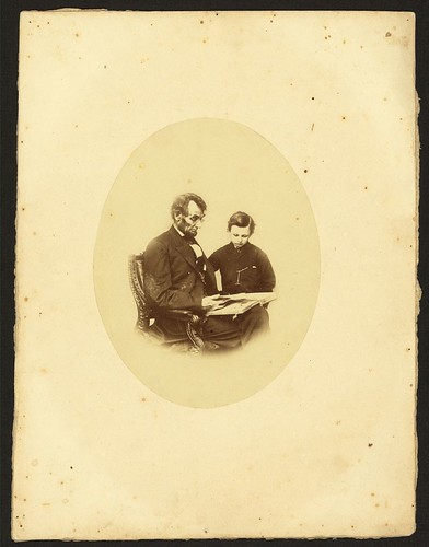 [Abraham Lincoln, U.S. President, looking at a photo album with his son, Tad Lincoln, Feb. 9, 1864] (LOC)