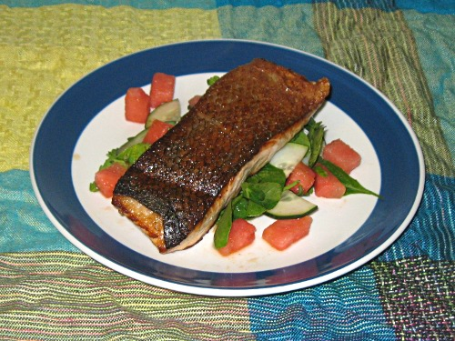 salmon with watermelon cucumber and arugula