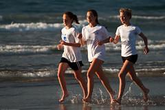 Three high school girls, as part of a larger g...