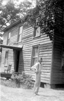 Lawrence Morton at back corner of old home place.