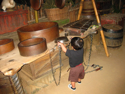 Theres a play area at the end of the treehouse path where you can play the pots and pans.  Emmett is barely tall enough to reach the bottom pans.
