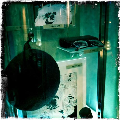 Tezuka's trademark beret and glasses