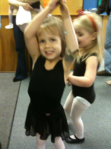 Dancing with her helper arm!
