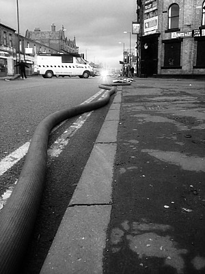 inflatable water pipes snaking up the road. I think they were running out of water, or needed a bigger fire hydrant, i dont know, because earlier they were connected to a different point further down the road, closer to the seat of the fire. Obviously theyre still damping down.