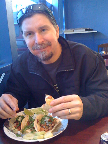 Taco enthousiast (and co-worker) Jeff cant wipe the damn smile off his face as he eats tacos at Chungas.  He was recently quoted as saying The chicken tacos were good.  But when I tried the al pastor it was like I was transported... to another planet.  I recorded that on my phone.  Because I am a professional taco journalist.