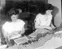 Mirta Perez and Angie Valdez working on cigar packaging process: Tampa, Florida