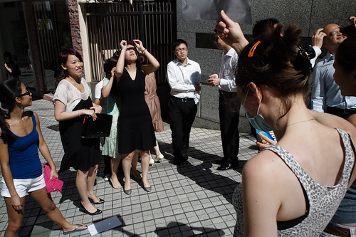 People watch the solar eclipse in Hong Kong