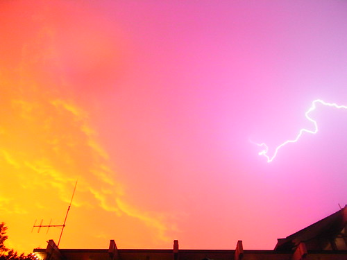 Lightning backed with a purple-orange sunset in Vancouver 7/25/09 (photo source: Michael ONeill! on Flickr)