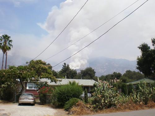 smoke on the ridge behind houses