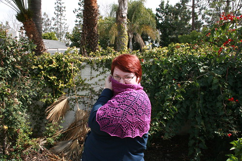 Swallowtail Shawl in class preita pose with only 1/2 my face showing.