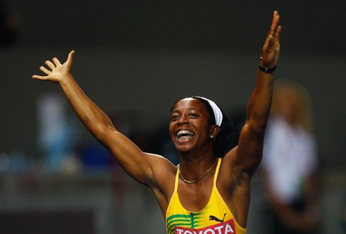Shelly-Ann Fraser of Jamaica celebrates winning the gold medal in the womens 100 Metres Final during day three of the 12th IAAF World Athletics Championships at the Olympic Stadium on August 17, 2009 in Berlin, Germany. (Photo by Stu Forster/Getty Images)