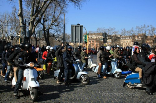 Owners and Tourists mounted on a Vespa, ready for the Tour