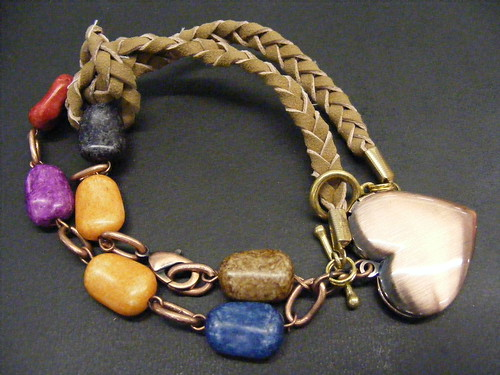 Combined Wooden Bead bracelet with heart locket and braided suede bracelet extender looped on one end and attached with its toggle clasp around the other end