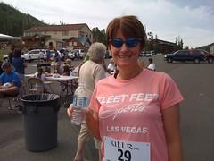 My mom post-race. I dress her in Fleet Feet Las Vegas apparel!
