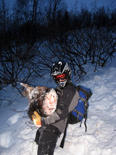 Mikey with the frozen head of a moose