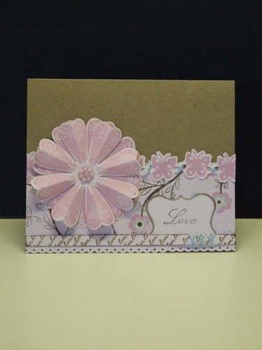 What a lovely effect adding detail to the petals of her focal point flower with stamp kissing in this card!