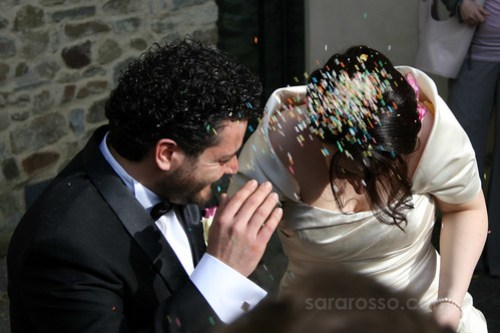 Italian bride and groom anticipating a shower of rice at their wedding