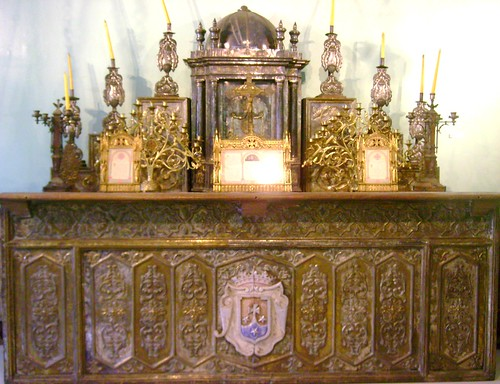 A beautiful altar with its sacristy, adored with gold and silver
