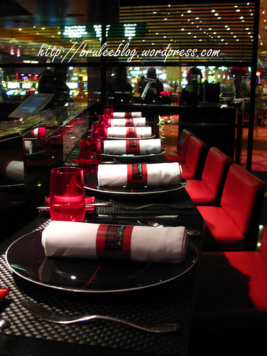 bar seating at LAtelier de Joël Robuchon with the casino viewable through the window