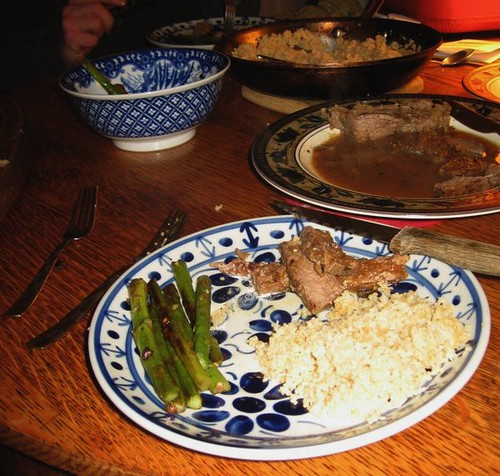 Citrus Beef with sauteed asparagus and coucous