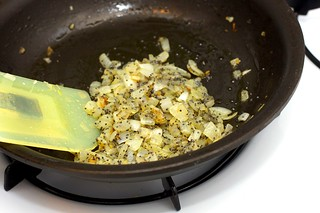 sauteeing onion-poppy topping