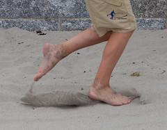 Michael kicks sand