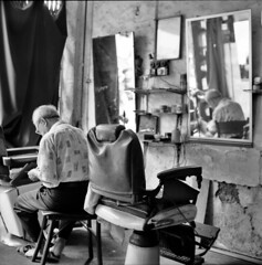 a glimpse inside a barber's every day life (lcy) Tags: travel bw 6x6 tlr monochrome mediumformat candid urbandecay ishootfilm unesco worldheritagesite squareformat barber malaysia nostalgic dailylife oldpeople mirrorshot melaka malacca 120mm oldshop  kodak400tmax vanishingtrade rolleiflex28e dyingtrade schneiderxenotar canoscan8800f traditionaltrade