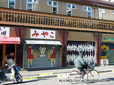The closed stores have beautifully painted shutters though