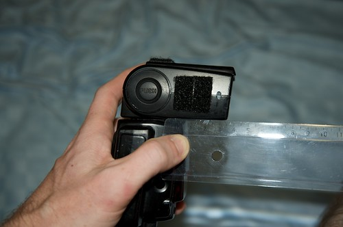 Measuring the depth of the flash head.
