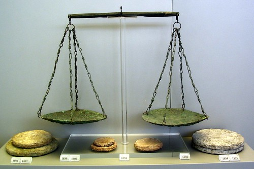 Bronze balance pans and lead weights from the Vapheio tholos tomb, circa 15th century BC. National Museum, Athens. Shot courtesy dandiffendale@Flickr. by-nc-ca license.