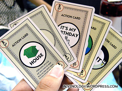 Money, property and action cards are all mixed together