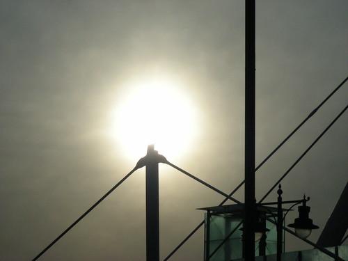 sun rising over pillar