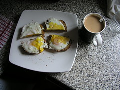 Fried eggs on toast and a cup of tea for breakfast