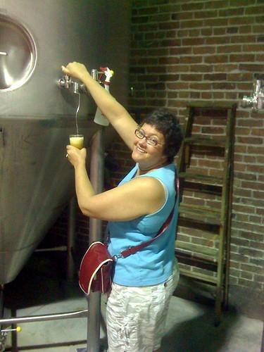 Mrs. Beerblog serving herself a very fresh Marzen.