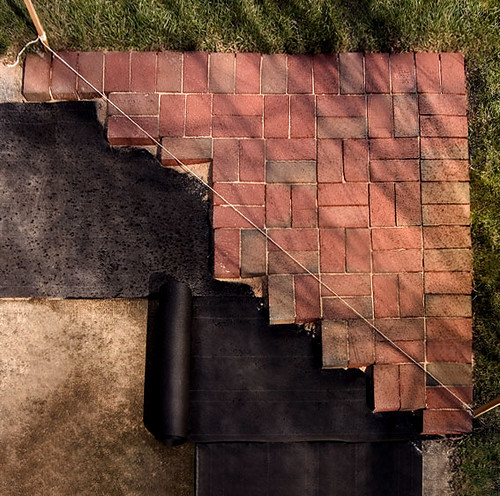 Turn an ugly concrete slap into a beautiful brick patio in one afternoon.