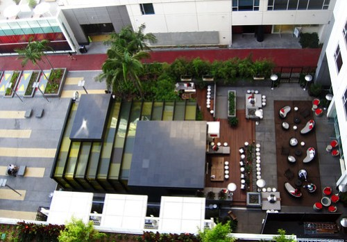 To the left: the Red Line portal and plaza. To the right: the W Hotel outdoor lounge.