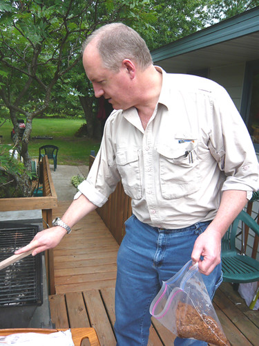 Kev - firing up the grill with his soaked wood chips