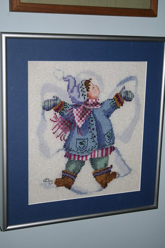 Framed 'Giggles in the Snow' cross stitch piece