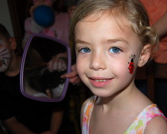 I painted a ladybug on Lizzie's cheek at Jacob's 6th birthday party.