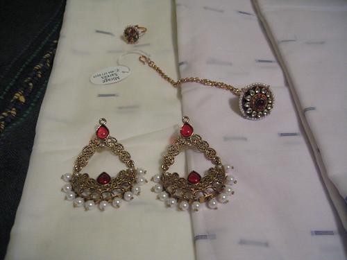 earrings, ring, tikka by you.
