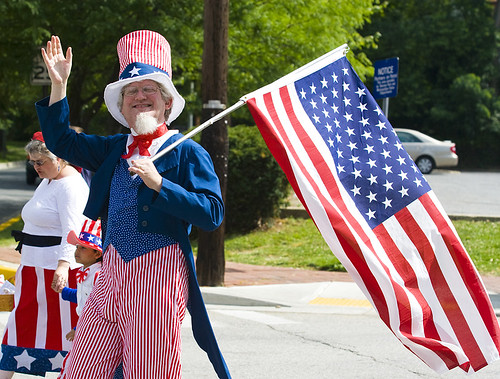 Jeffrey Silverstone, in his fifth year as Uncle Sam, waves to spectators during Takoma Parks 120th annual Independence Day parade on July 4, 2009.