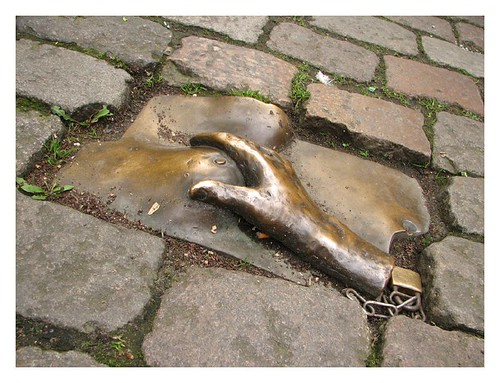 Bronze women's bust in the pavement in front of the Oude Kerk -Amsterdam Red Light District by you.