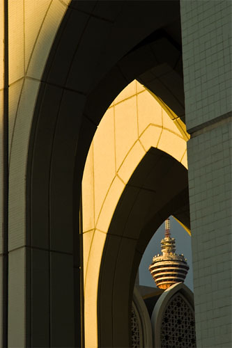 Kuala Lumpur Tower framed by arches of the Dayabumi Complex