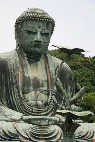 the great buddha, or daibutsu as hes called peacefully ignores the crowds of admirers.